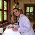Tracy Chevalier in the The Plankbridge Hutmakers Ltd garden